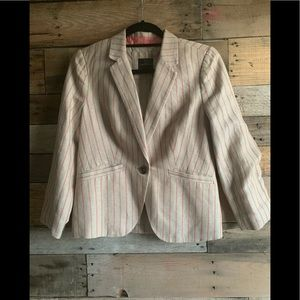 Tan pin-stripe blazer with coral accents.